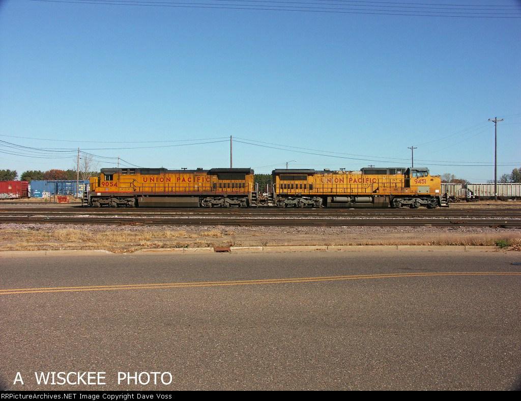 UP 9054 & 9451 await a call at Altoona